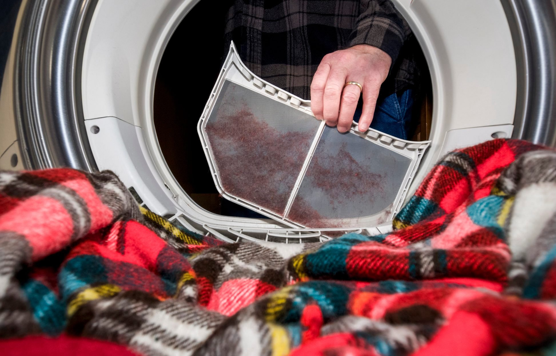 Clothes Dryer from Inside Lint Trap Lifted to Clean Close-up