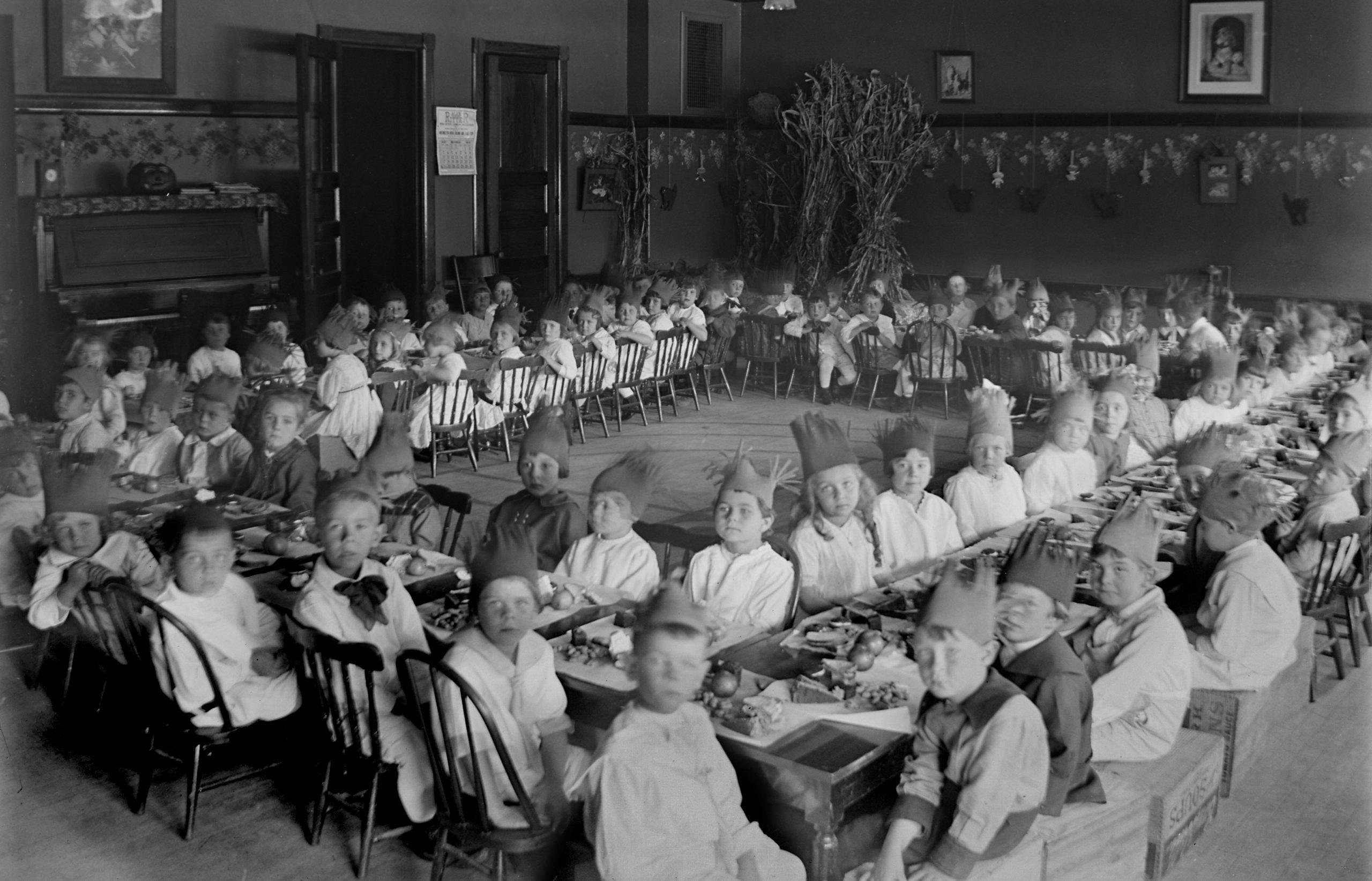 Turkey dinner in the elementary school classroom, ca. 1910.
