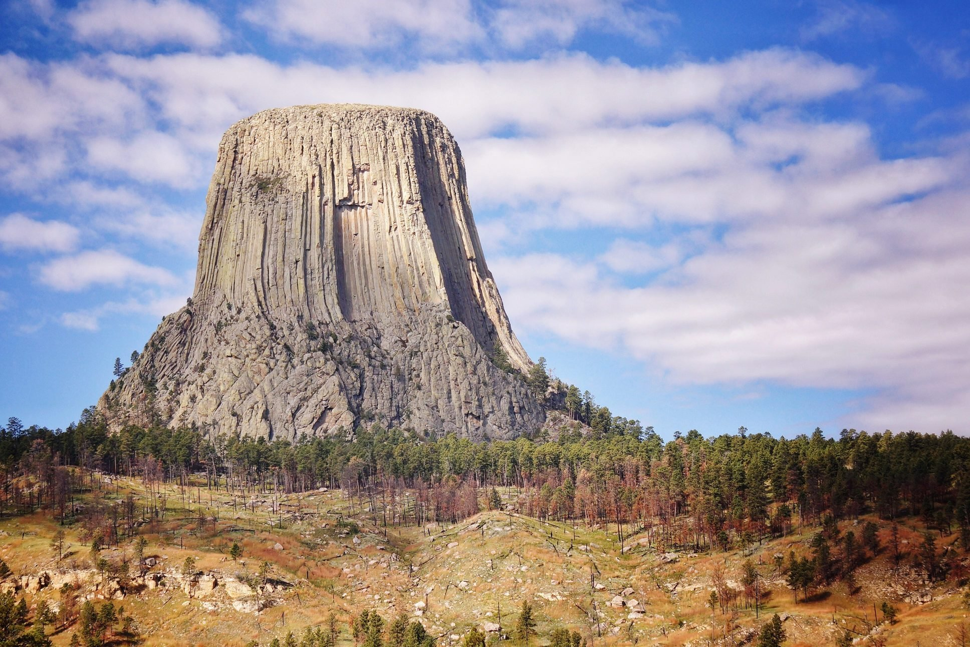 Low Angle View Of Devils Tower National Monument Against Cloudy Sky