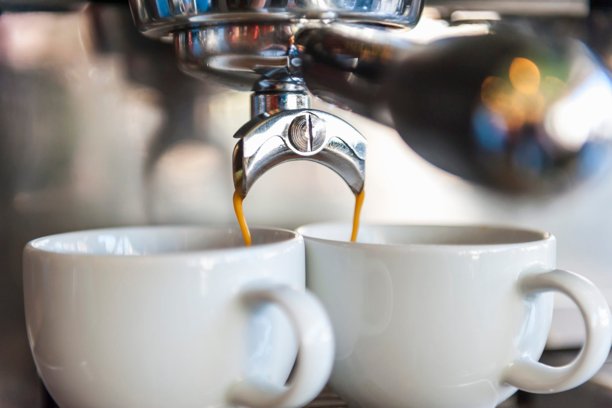 Coffee machine preparing two cups of coffee