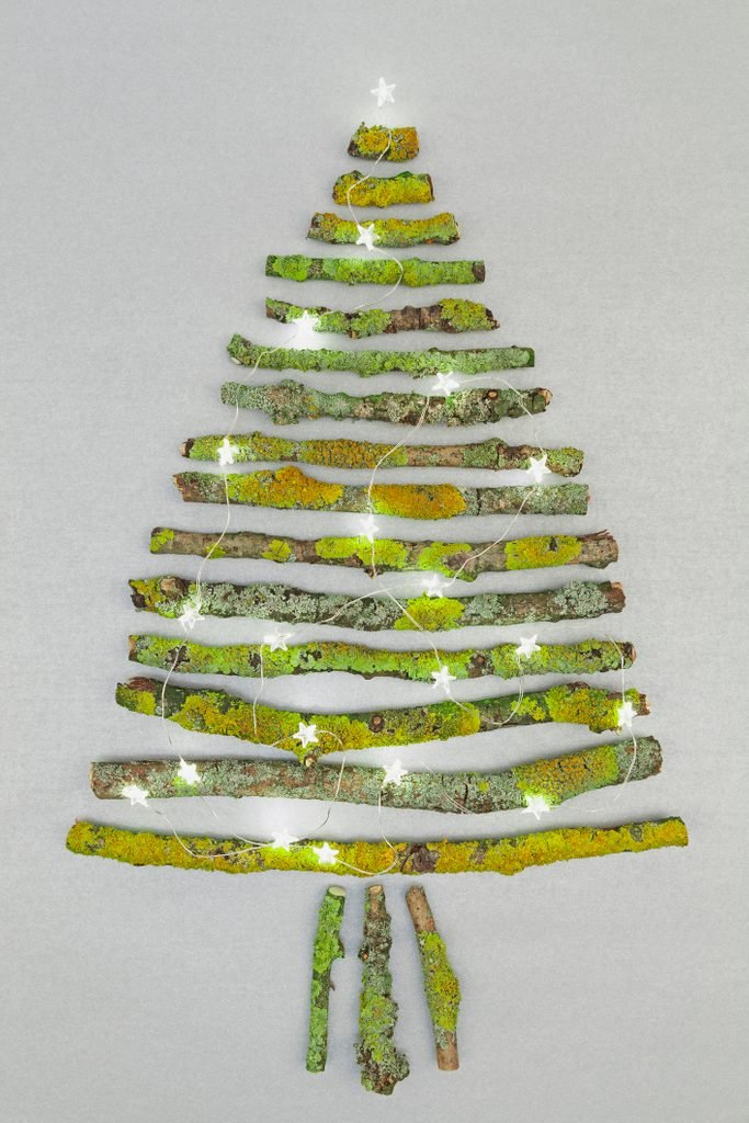Christmas tree shaped of mossy branches and Christmas decoration