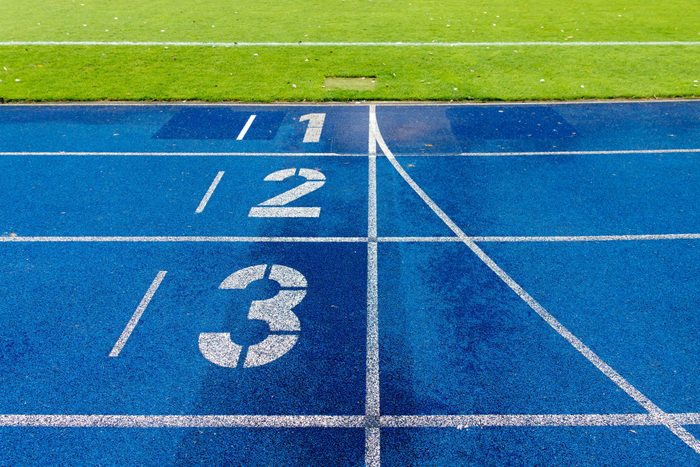 High Angle View Of Markings On Blue Sports Track