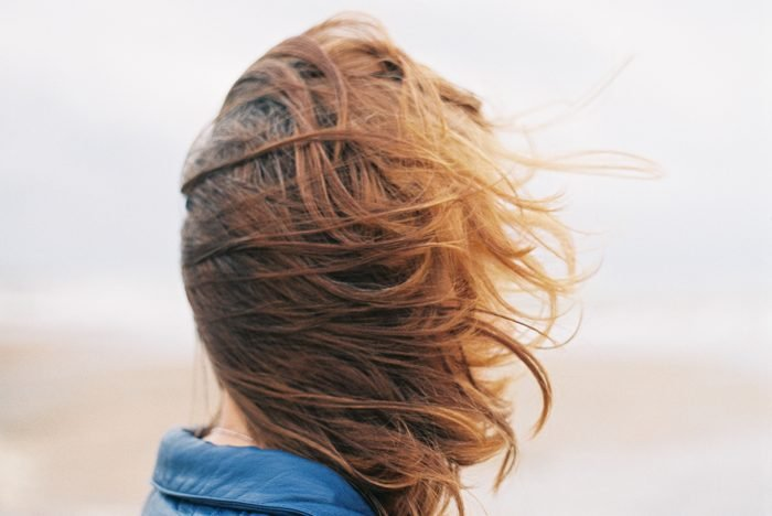 Close-up of a woman with windswept hair