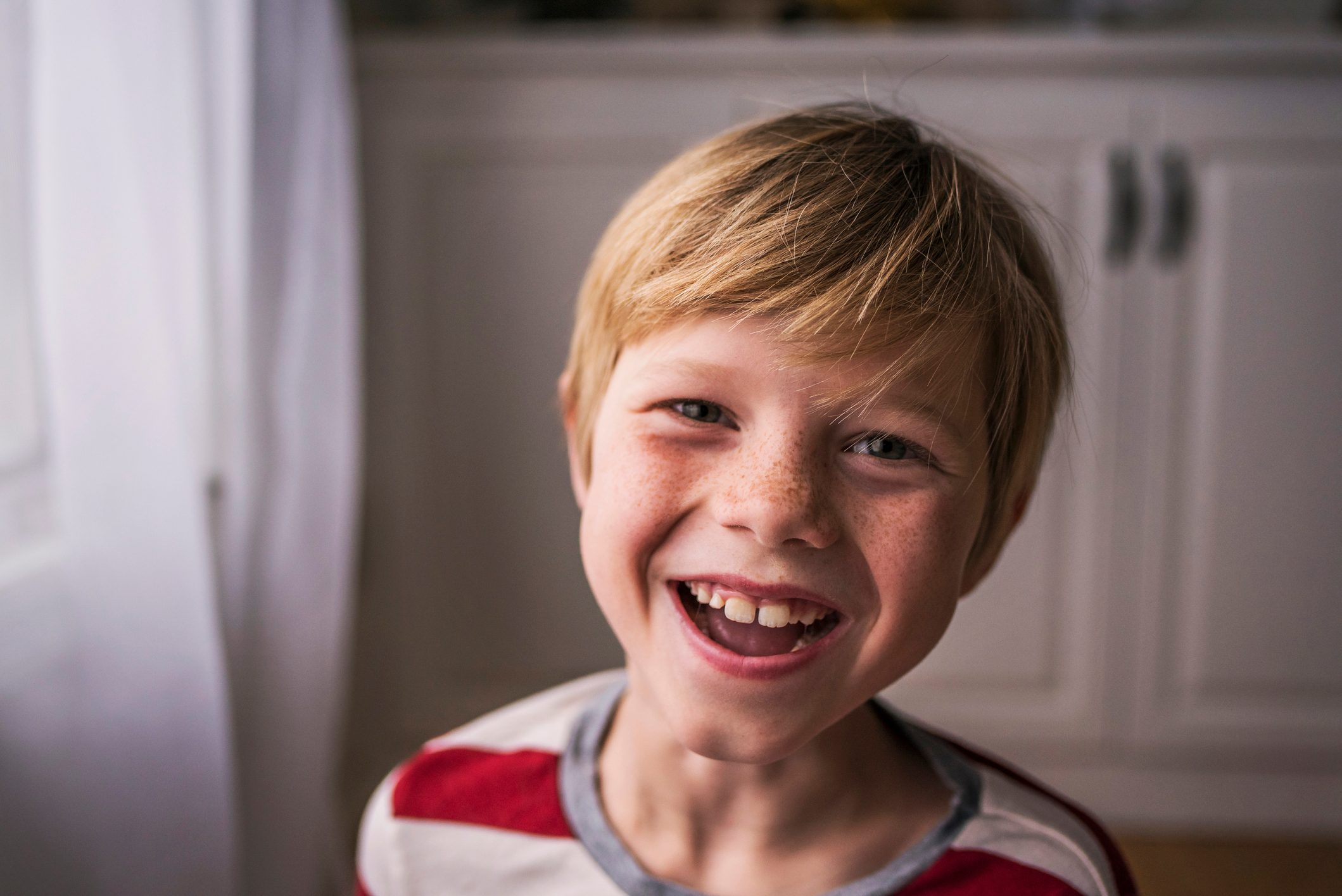 Portrait of a smiling boy with freckles