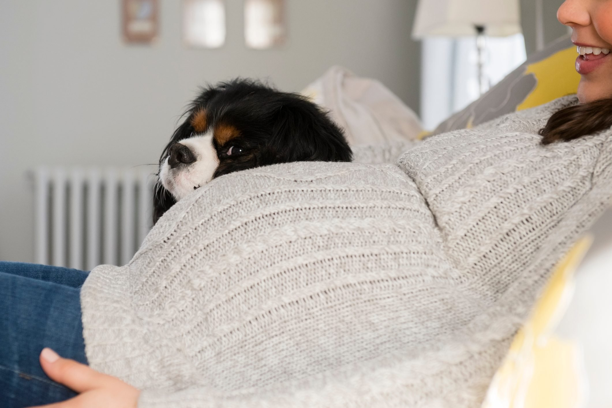 Side view of pregnant woman relaxing next to dog