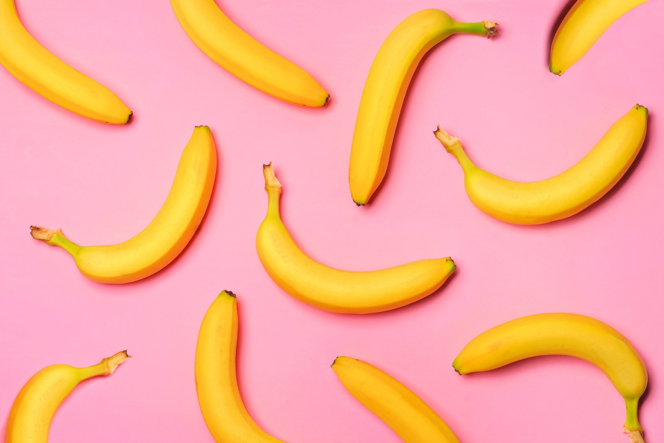 Fruit pattern of bananas over a pink background