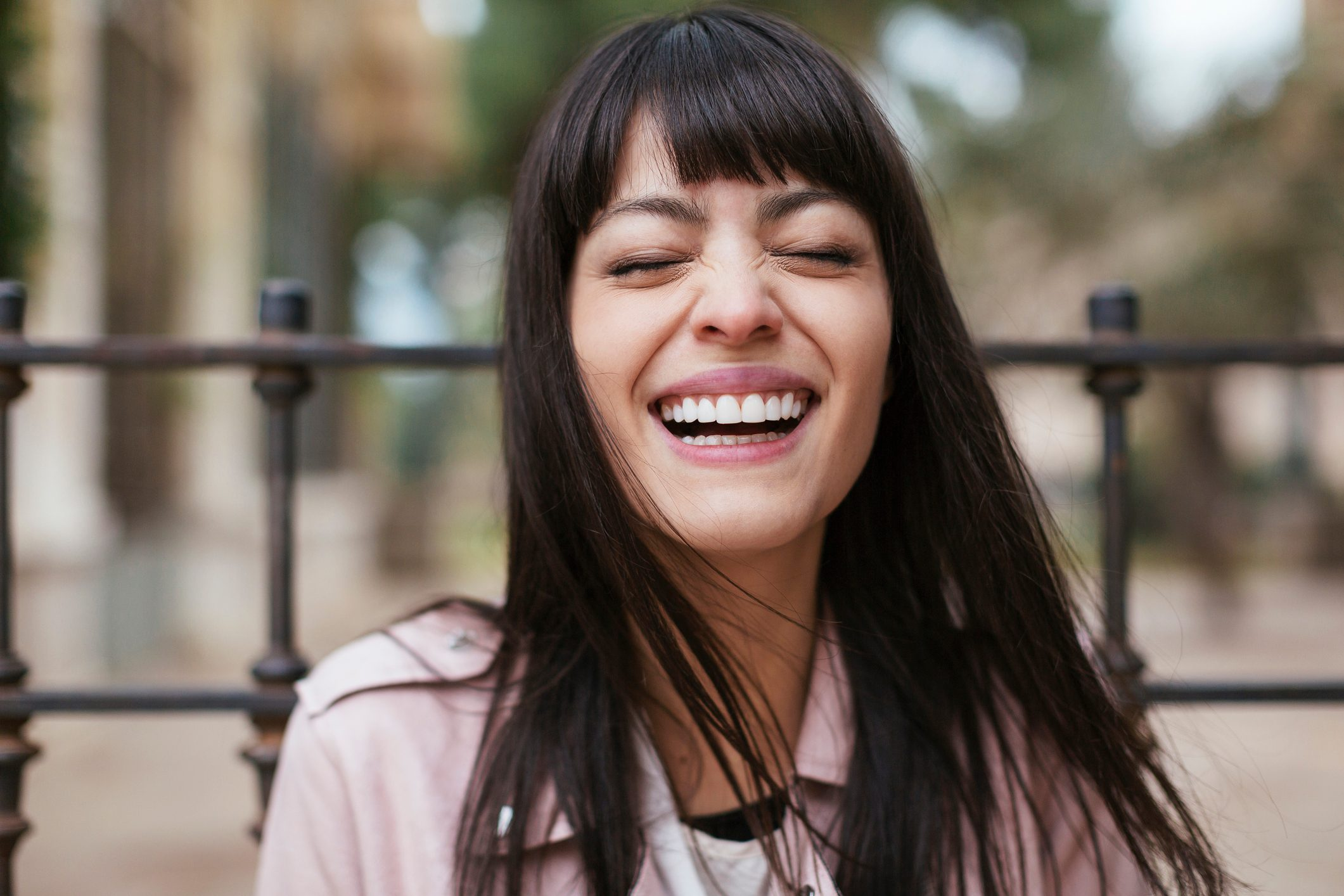 Portrait of laughing young woman outdoors