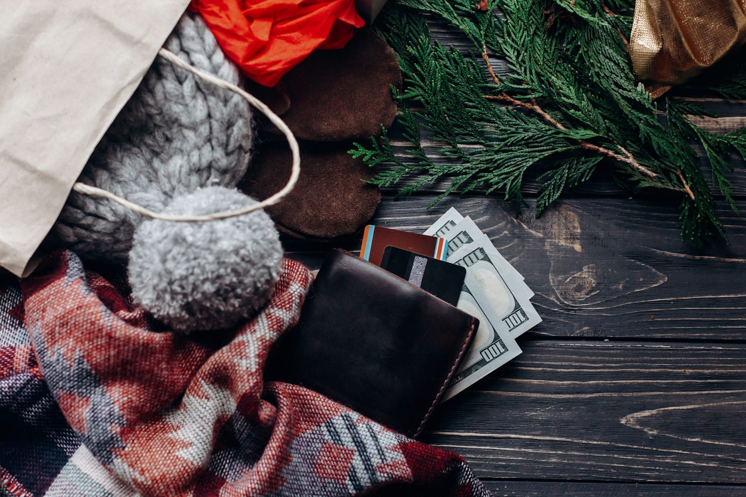 christmas shopping concept. big sale. seasonal rustic background with bags money credit cards wallet and bag with presents. advertising with space for text