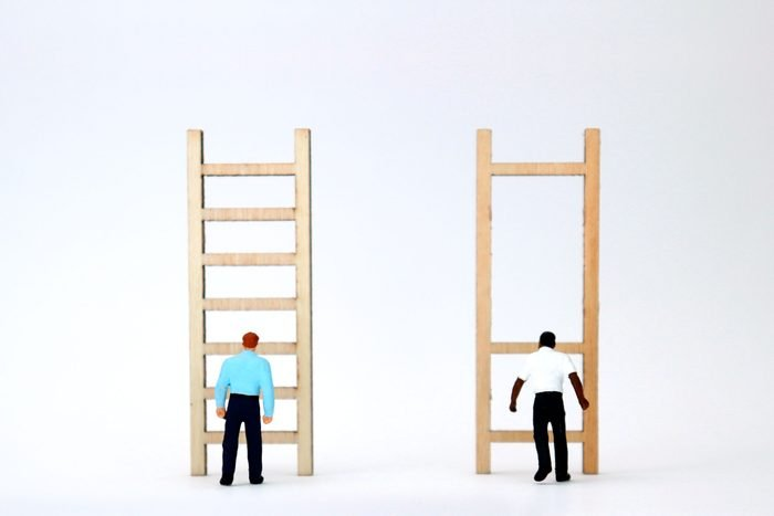 a white figure stands in front of a normal ladder and a Black figure stands in front of a ladder with only three, widely spaced rungs