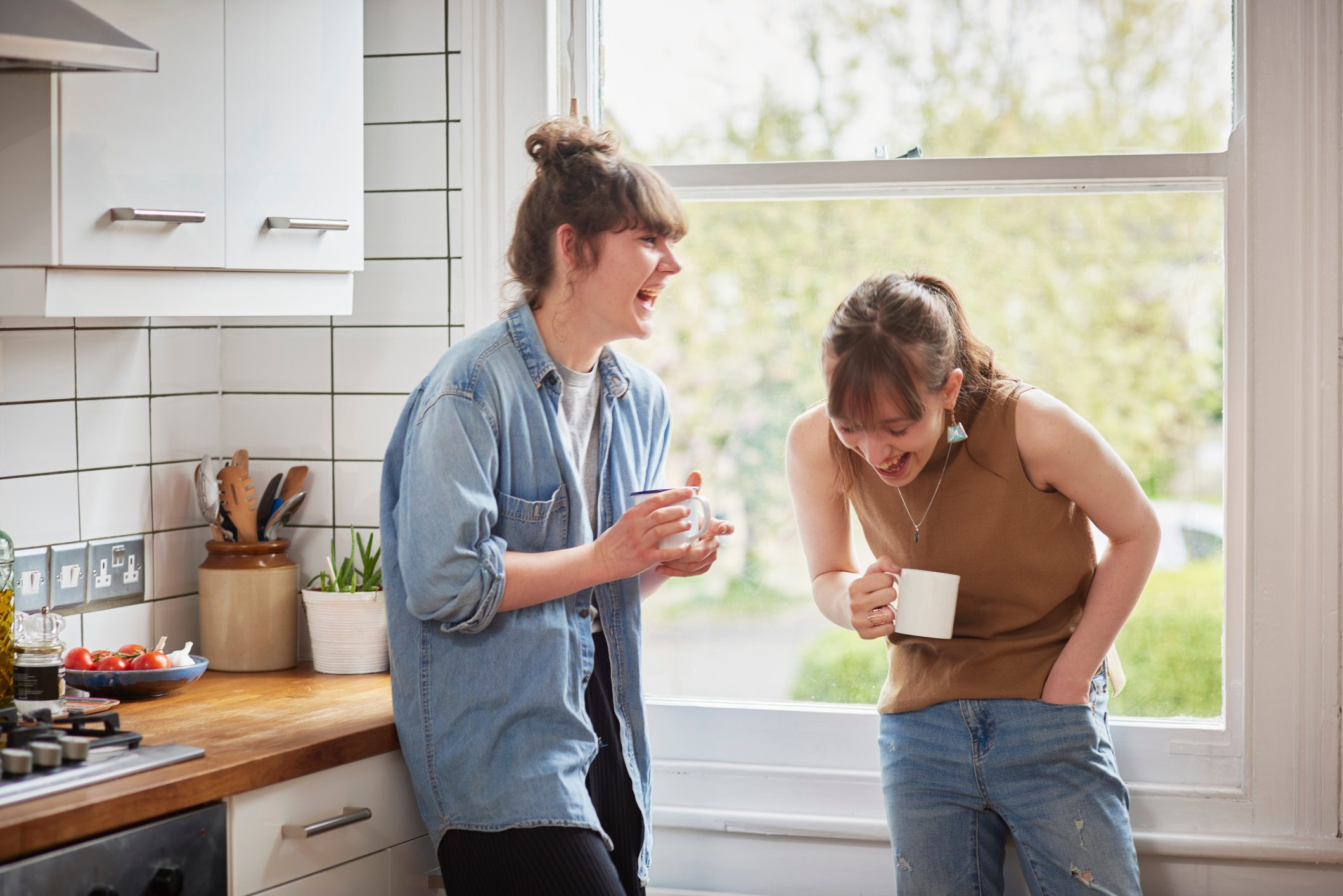 Friends chatting in kitchen