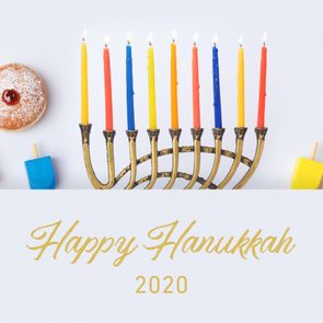 hanukkah props arranged on white background with text,