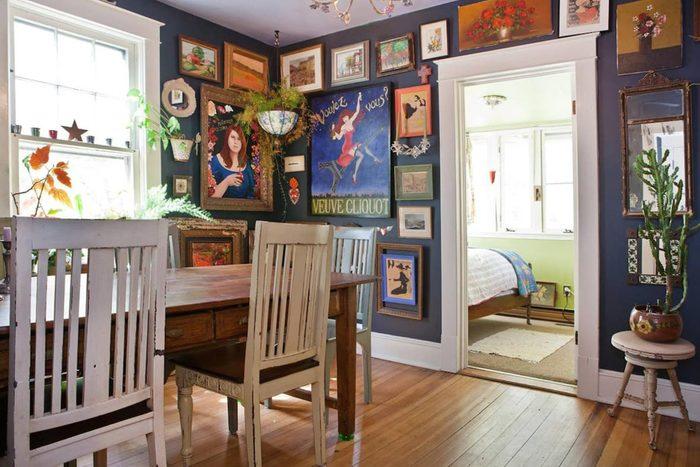 view of eclectic dining room with peak of bedroom in corner