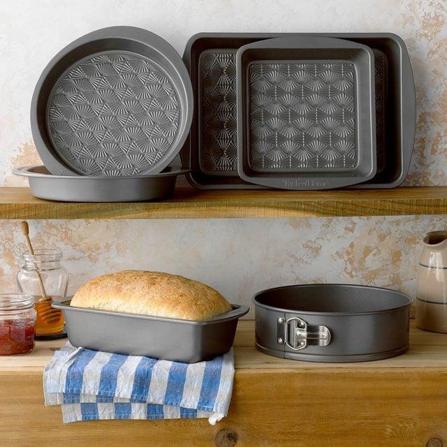 Taste of Home Bakeware on shelves in rustic environment