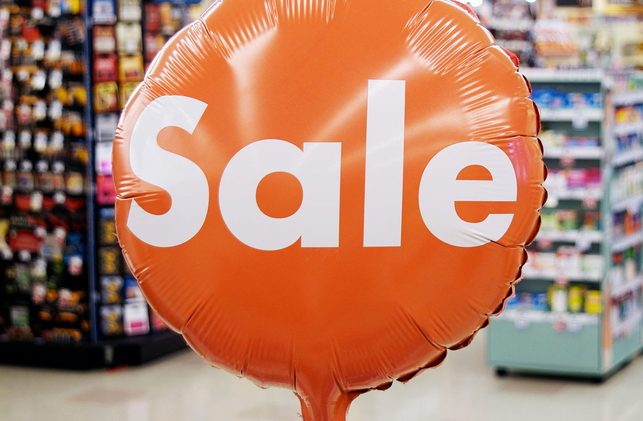 Orange sale sign in grocery store