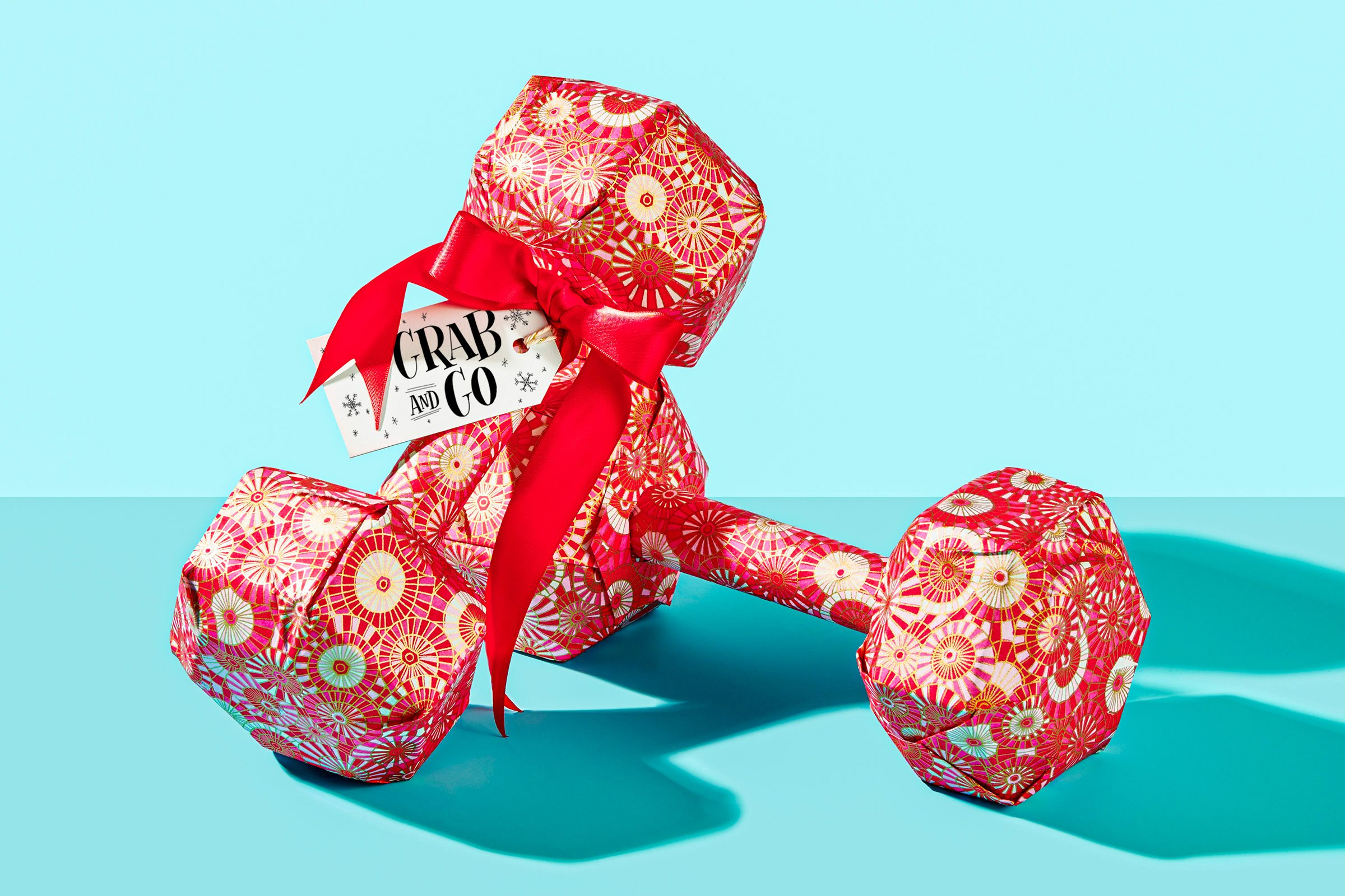 """wrapped hand weights set on blue background with gift tag that reads, """"Grab and Go"""""""