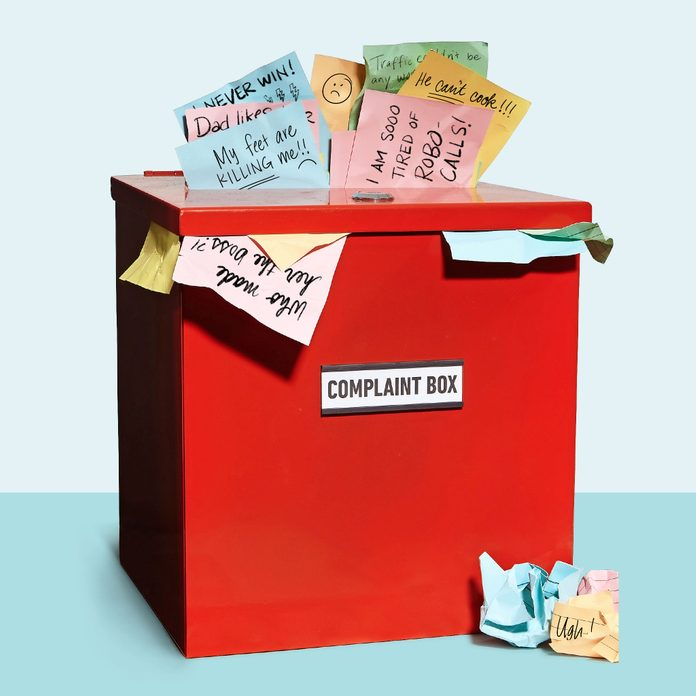 red complaint box overflowing with colorful note papers