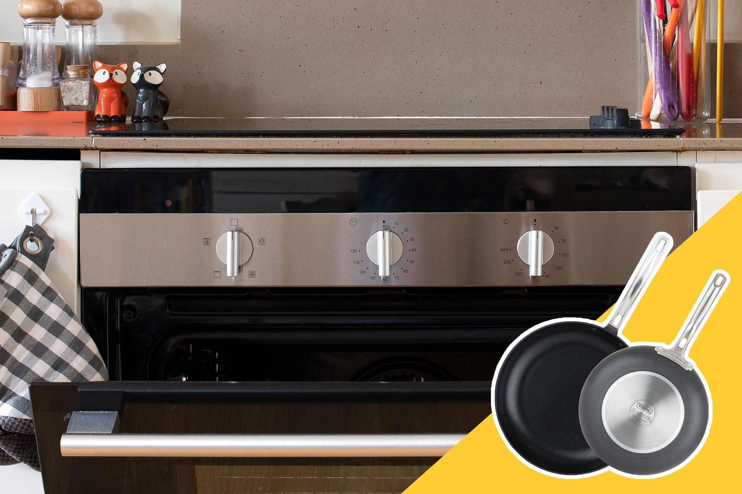 oven with door ajar; set of pans in inset