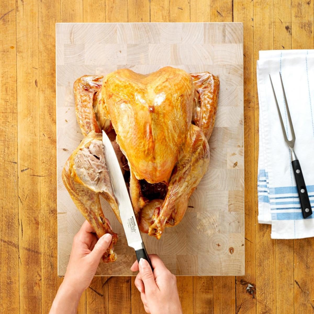 Image of cook carving a turkey