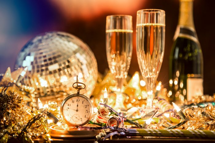 New Year's Eve holiday party, pocket watch, clock at midnight.