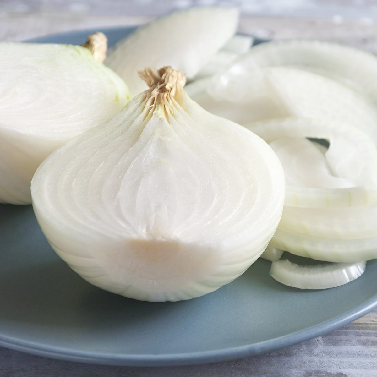 White onion on a wooden rustic table. Organic vegetables. Close-up of sliced raw organic white onion on a plate.; Shutterstock ID 681266095; Job (TFH, TOH, RD, BNB, CWM, CM): TOH
