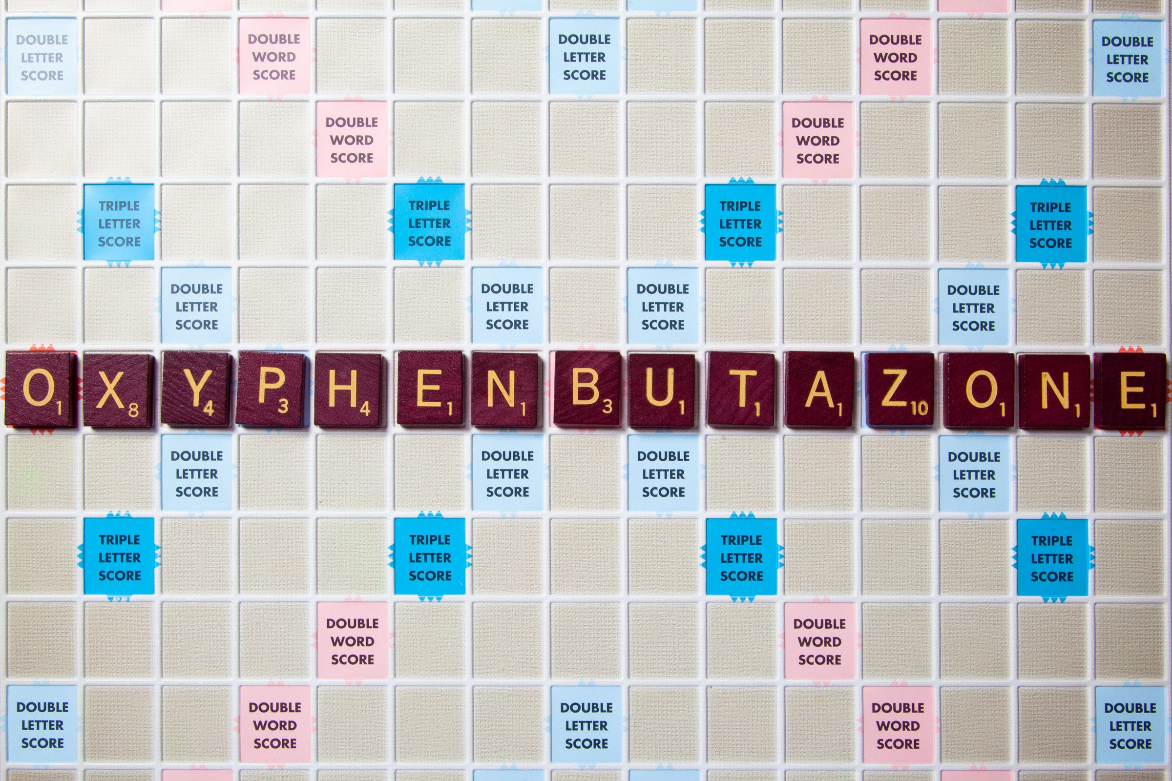 scrabble board with tiles that spell out oxyphenbutazone