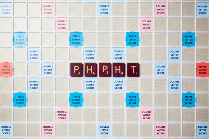 scrabble board with tiles that spell out phpht