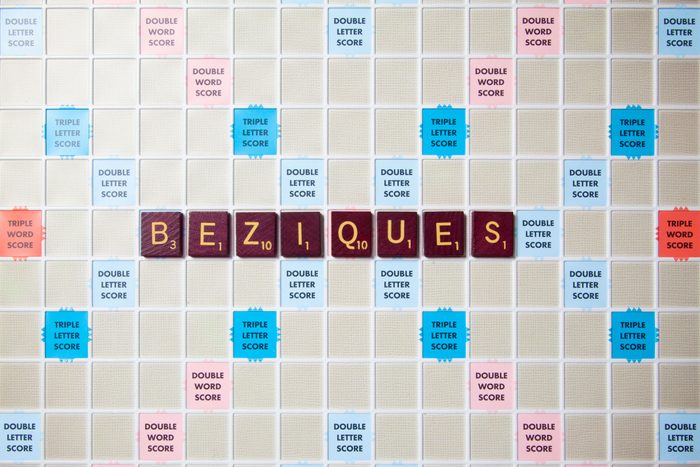 scrabble board with tiles that spell out beziques