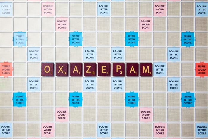 scrabble board with tiles that spell out oxazepam