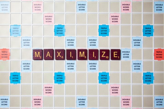 scrabble board with tiles that spell out maximize
