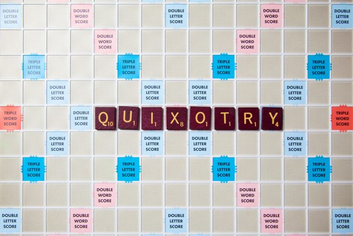 scrabble board with tiles that spell out quixotry
