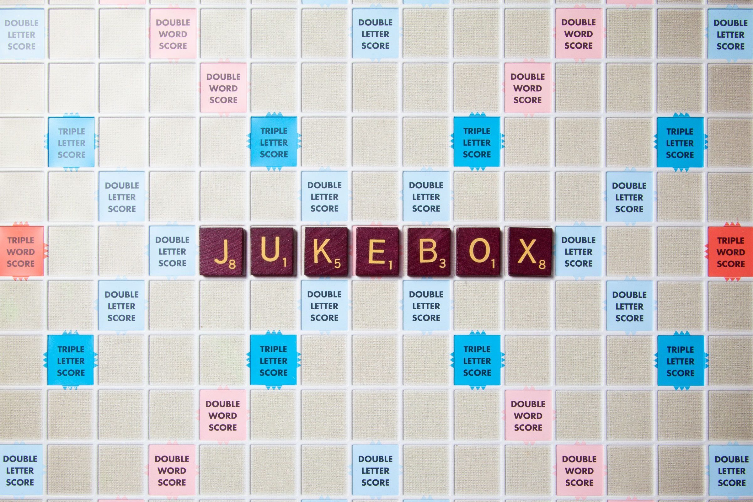 scrabble board with tiles that spell out jukebox