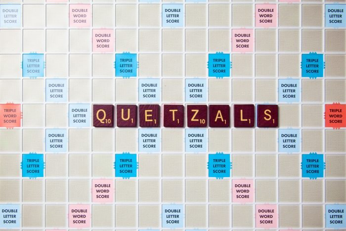 scrabble board with tiles that spell out quetzals