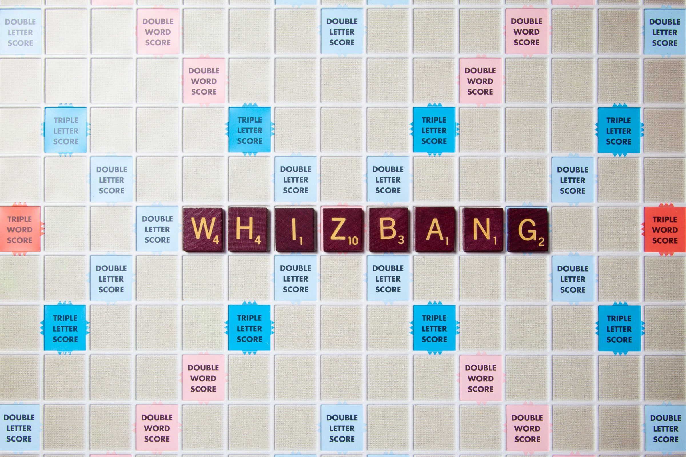 scrabble board with tiles that spell out whizbang
