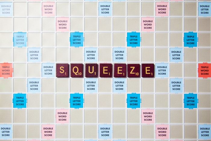 scrabble board with tiles that spell out squeeze