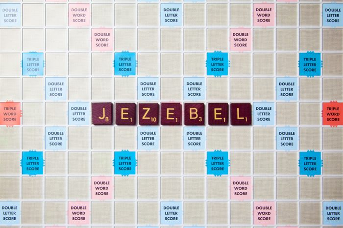 scrabble board with tiles that spell out jezebel