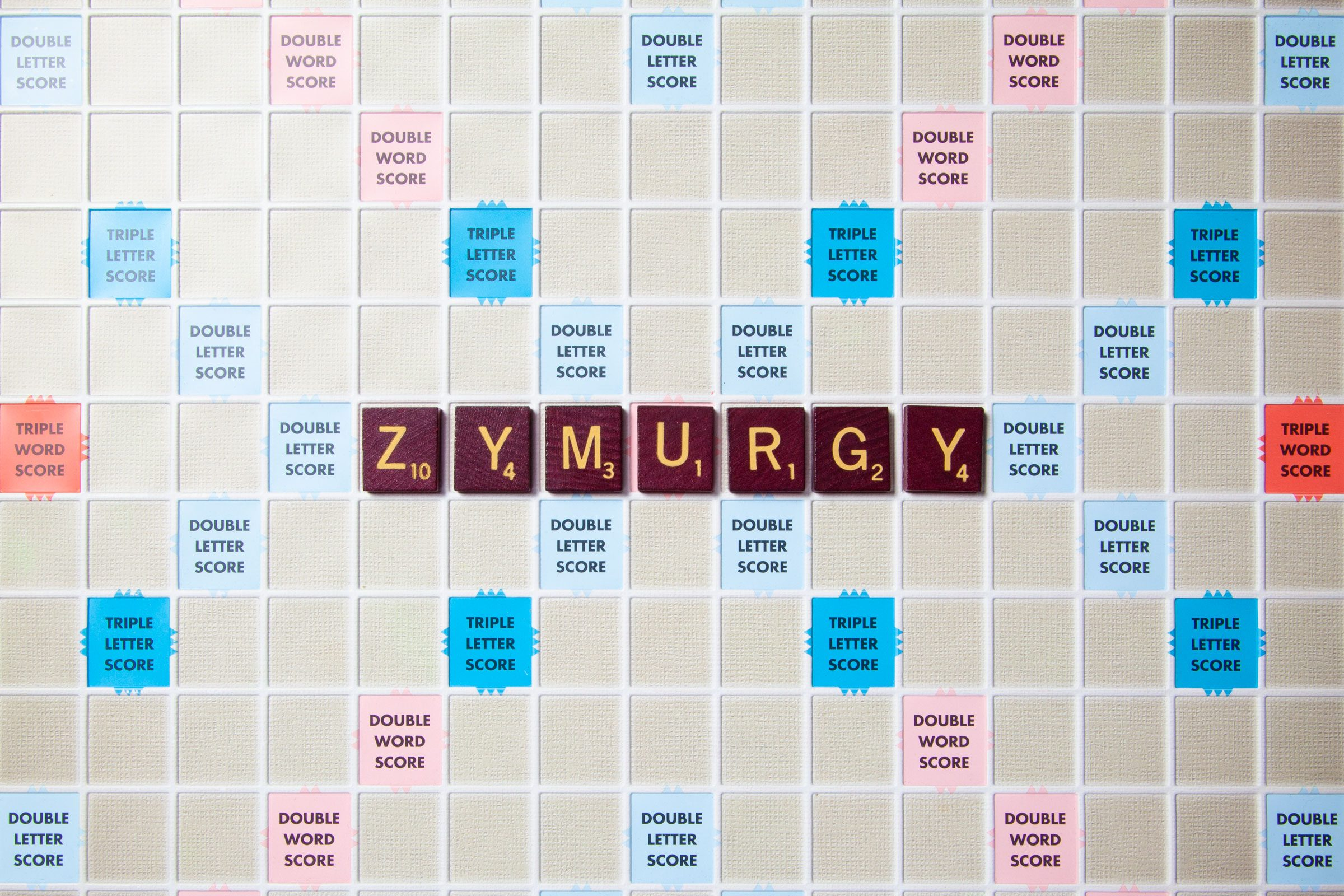 scrabble board with tiles that spell out zymurgy