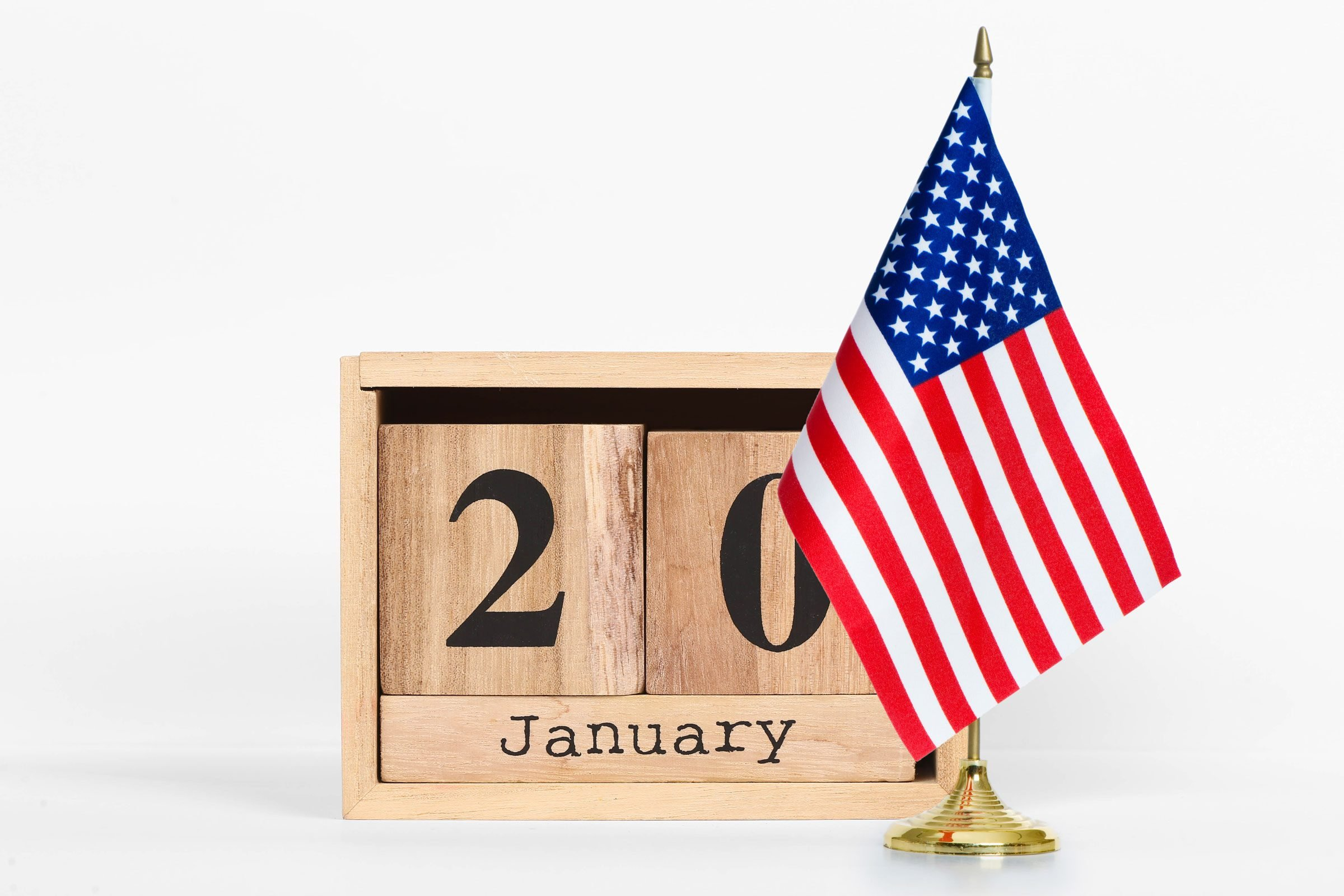 a perpetual calendar reads January 20 next to an American flag