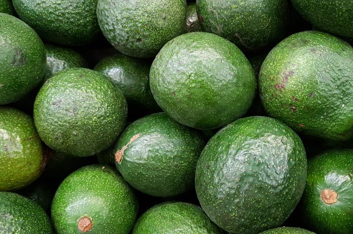 Lots of avocados at the market, full frame