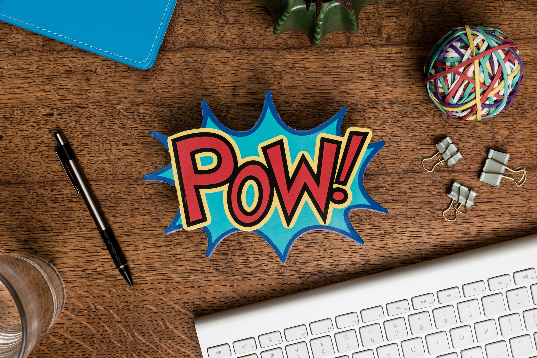 View from above POW sign on wooden desk