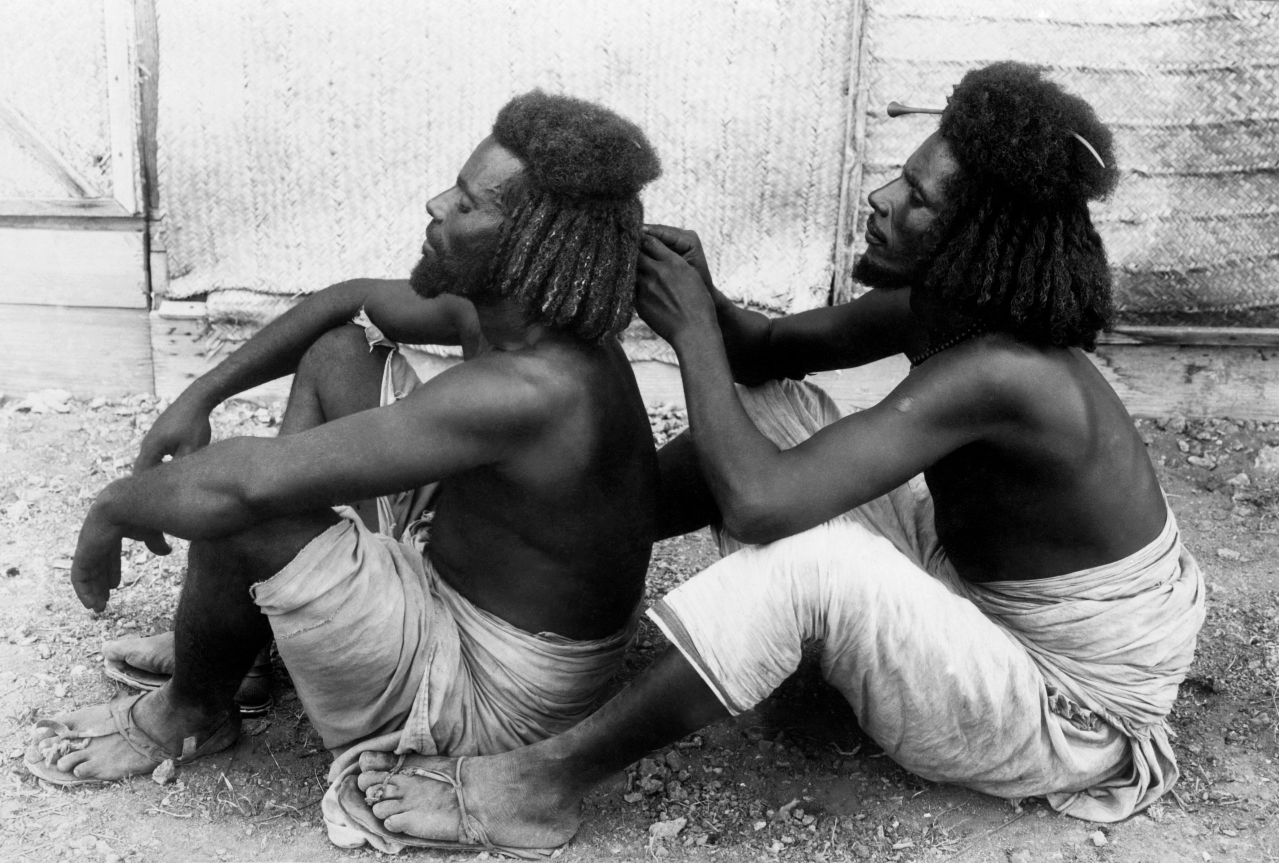 Africa, Eritrea, two young Habab care meticulously combing, 1910-20