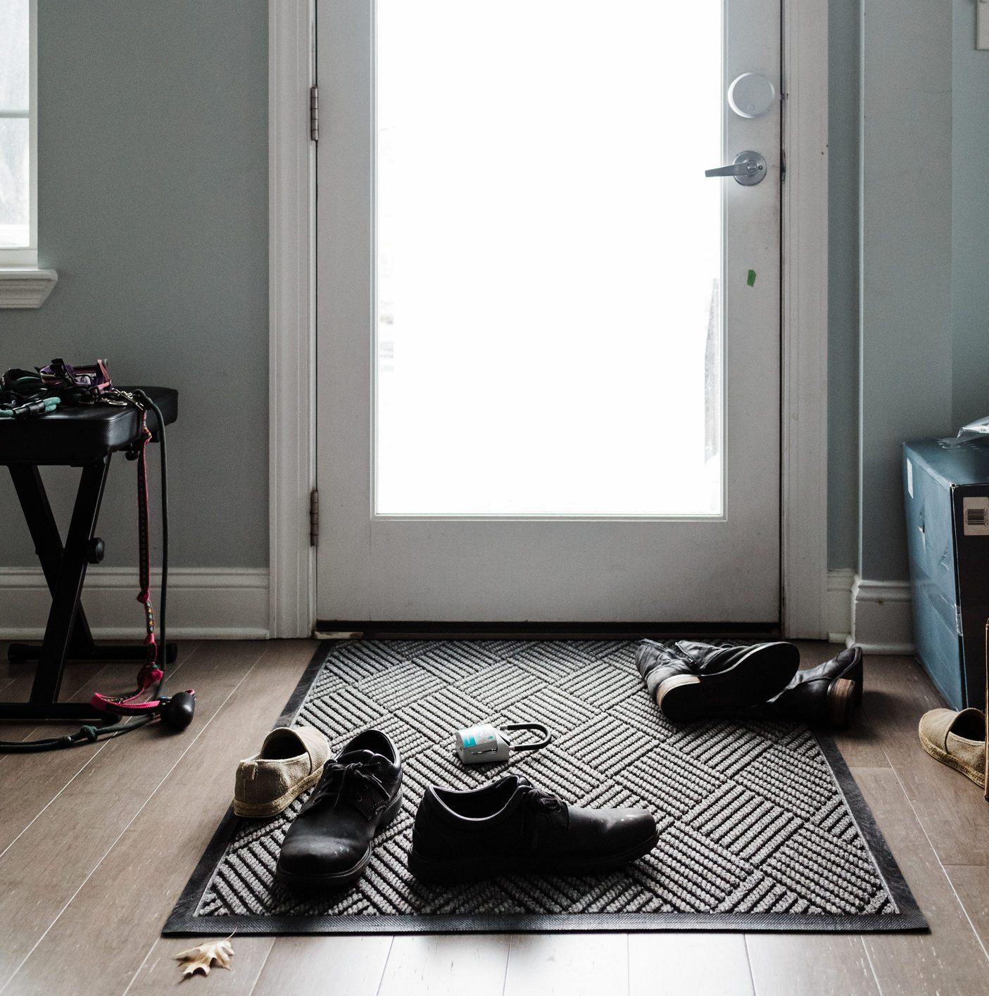 Messy shoes in front of door