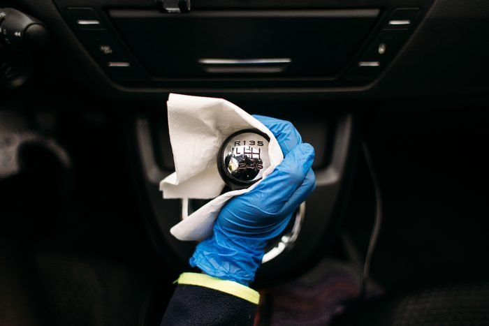 Wiping down gear shift lever in a car