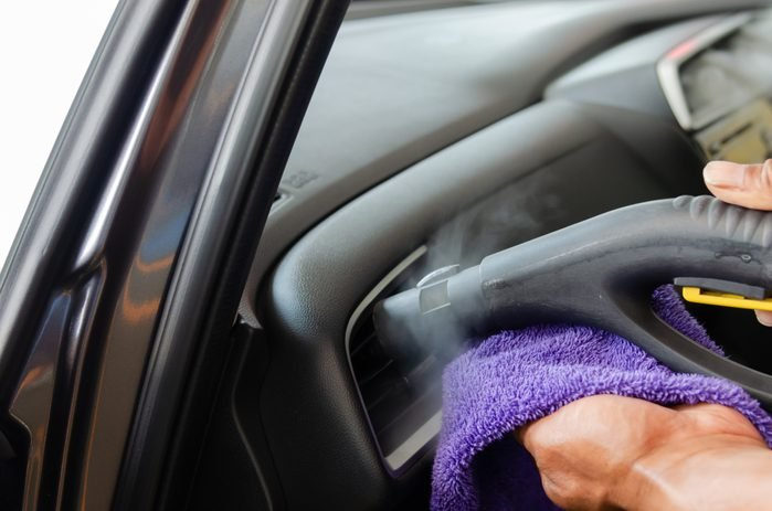 Cropped Hands Cleaning Car