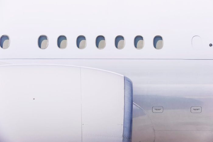 close up of engine and windows on airplane
