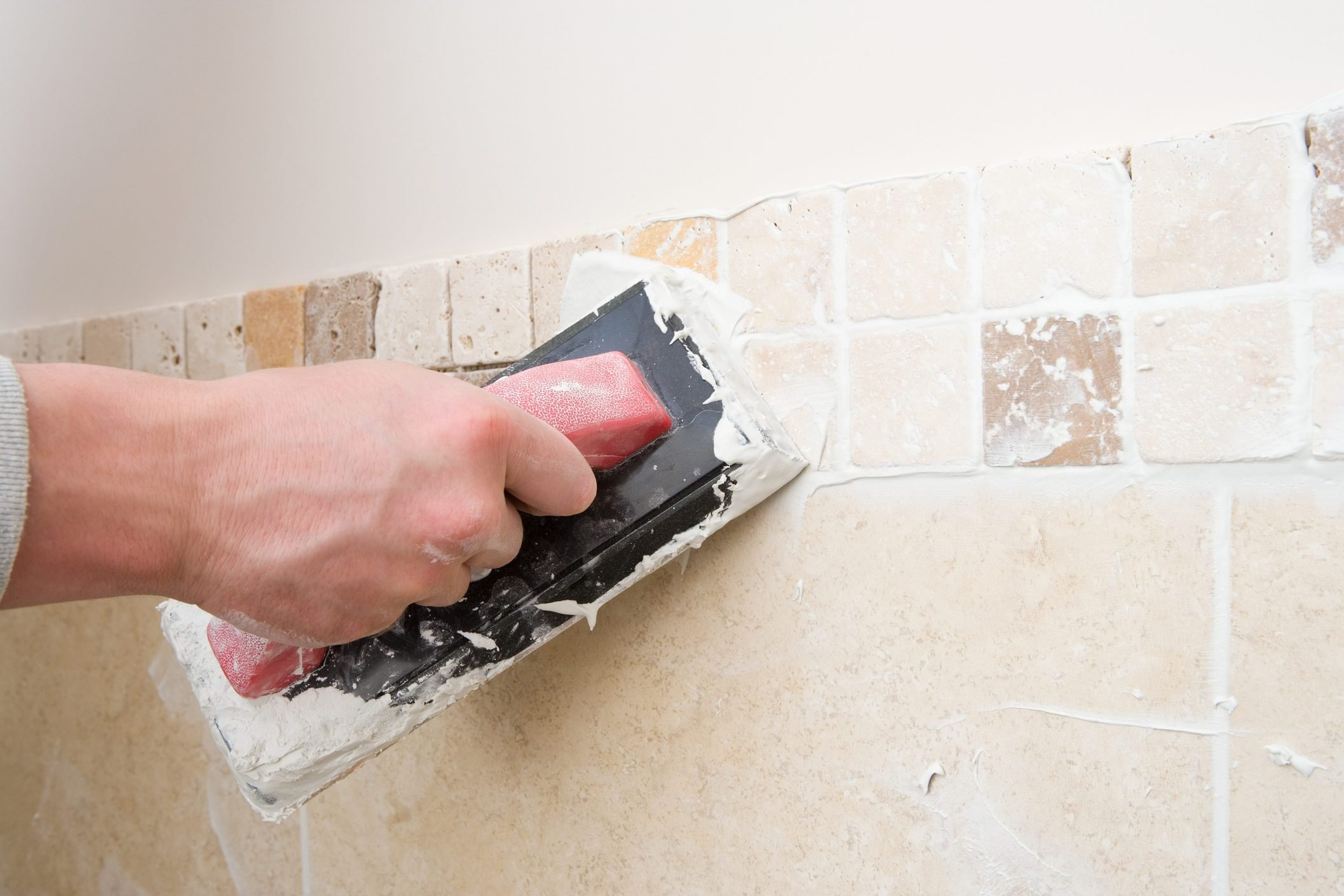 A decorator grouting tiles