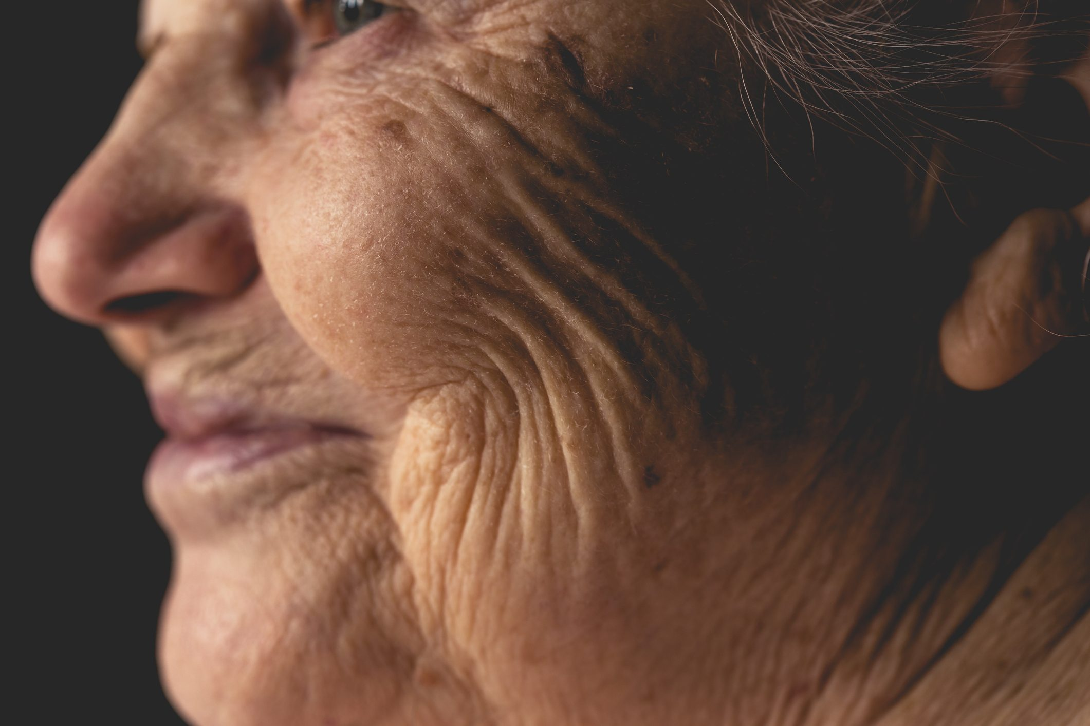 Wrinkled face of elderly woman, smiling details