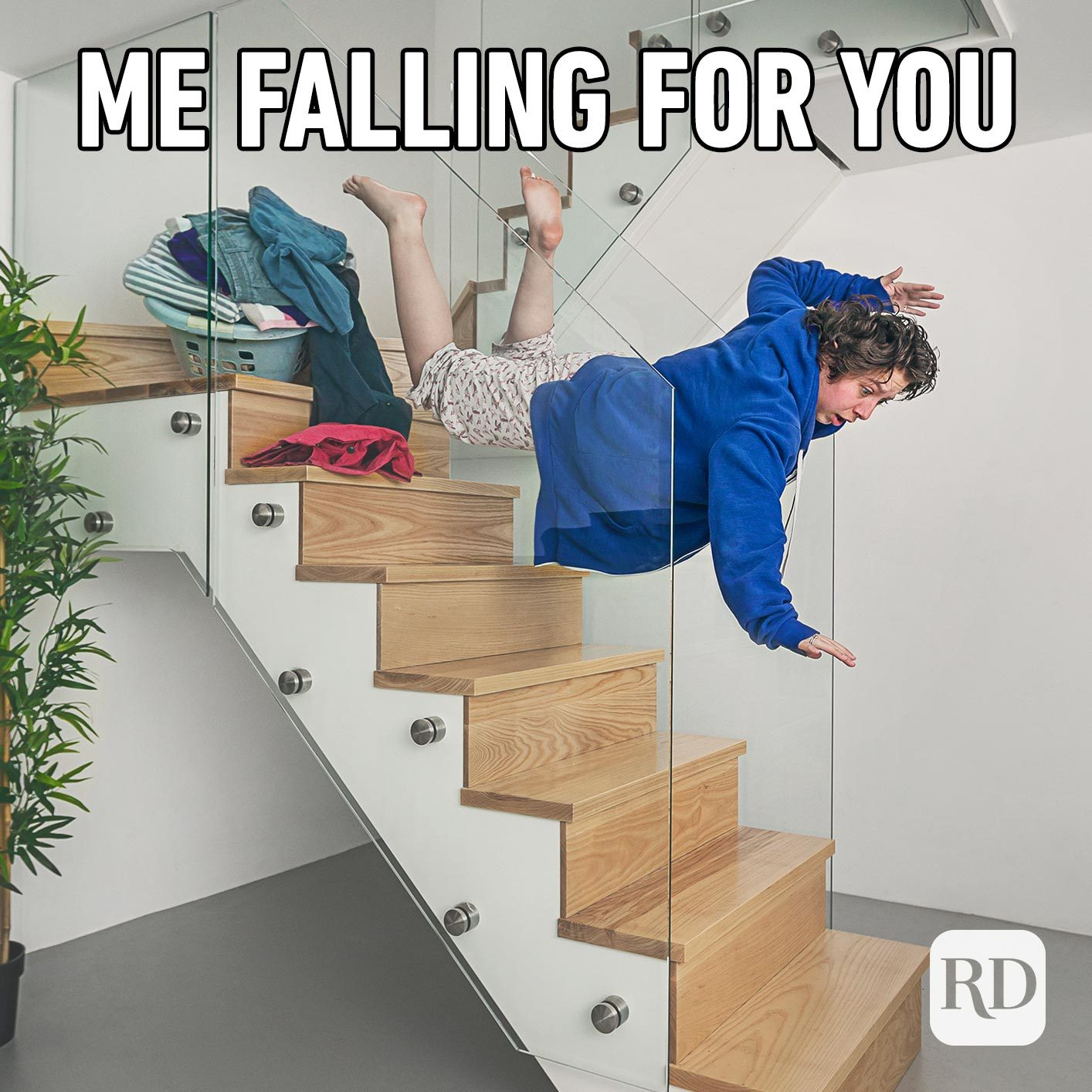 Woman falling down stairs. Meme text: Me falling for you.
