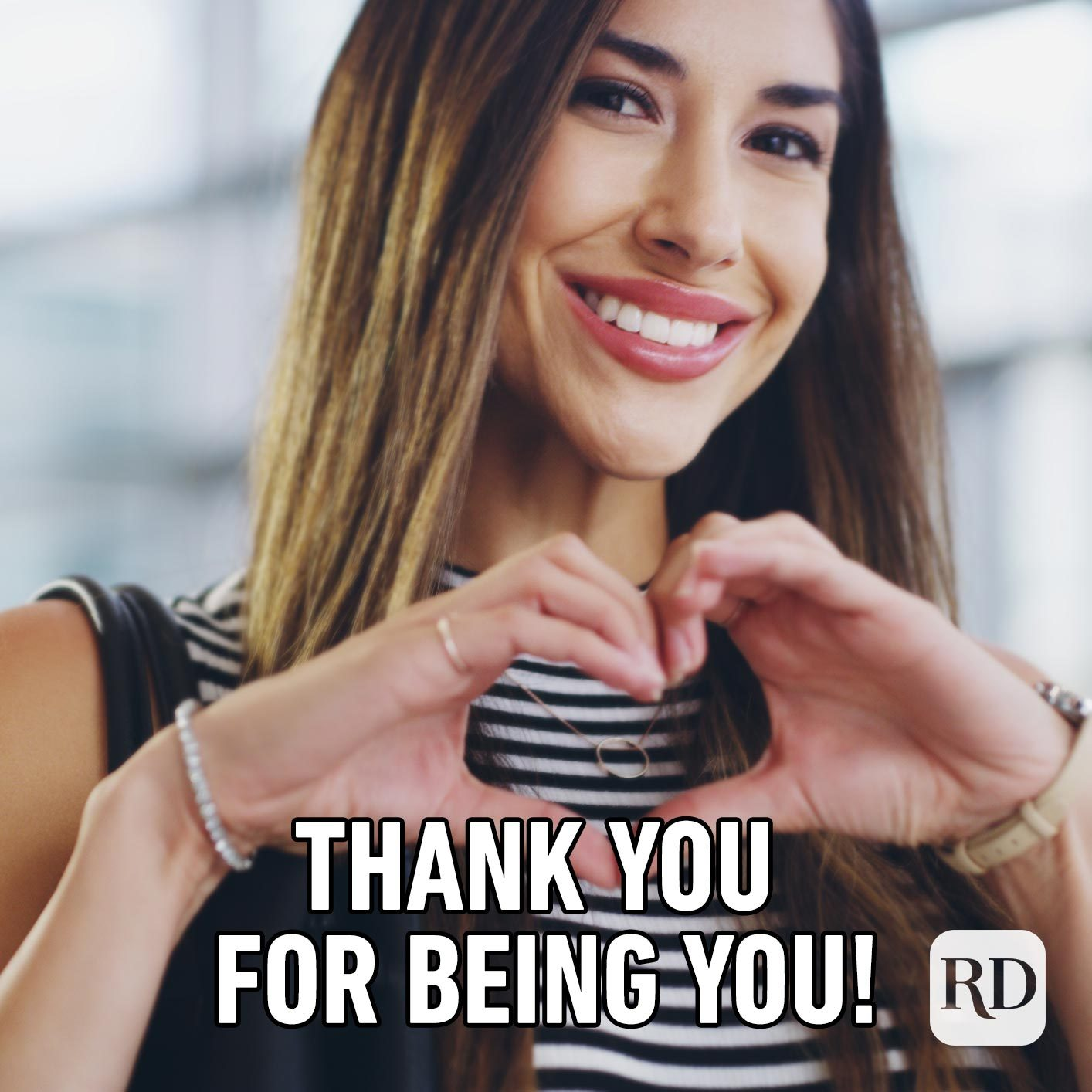 Woman holding hands in a heart shape. Meme text: Thank you for being you!