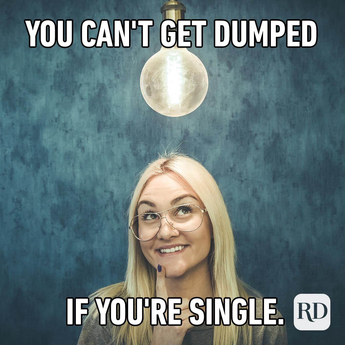 Woman underneath a lightbulb. Meme text: You can't get dumped if you're single.