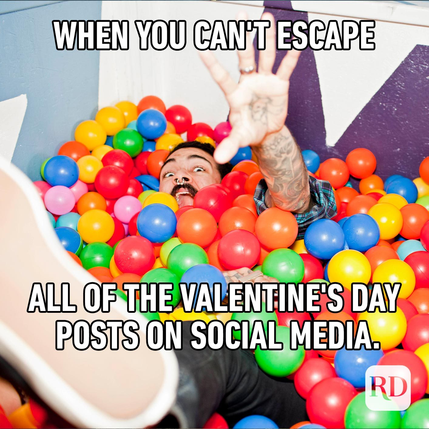 Man falling into a ball pit. Meme text: When you can't escape all of the Valentine's Day posts on social media.